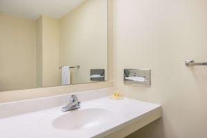 A bathroom at Days Inn by Wyndham St. Louis North