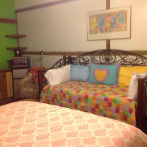 A bed or beds in a room at The Main Street Hotel