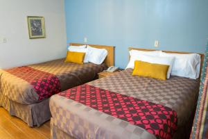 A bed or beds in a room at Townhouse Inn and Suites