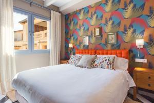 Cama o camas de una habitación en Llucmajor Suites