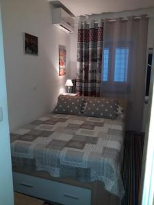 A bed or beds in a room at Apartments & Rooms No.1