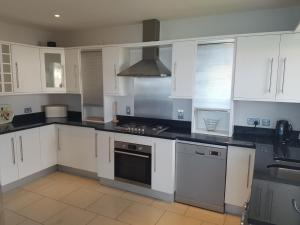 A kitchen or kitchenette at Ocean View Penthouse Portrush