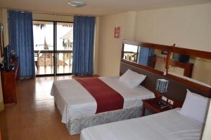 A bed or beds in a room at Asian Belgian Dive Resort