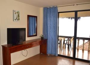 A television and/or entertainment center at Asian Belgian Dive Resort
