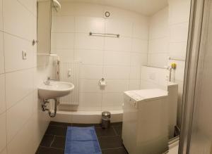 Ванна кімната в Ferienwohnung Weiken