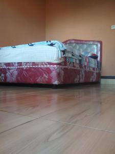 A bed or beds in a room at Bintang Senaru Homestay