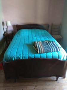 A bed or beds in a room at Ayres de Vistalba