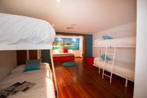 A bunk bed or bunk beds in a room at Sports Hotel Nayade