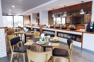 A restaurant or other place to eat at Hotel MAYU