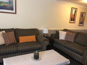 A seating area at Caulta Apartments