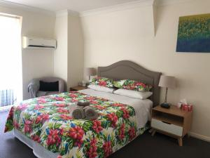 A bed or beds in a room at Caulta Apartments