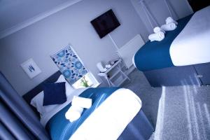 A bed or beds in a room at Rowton Poplars Hotel