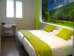 Cama o camas de una habitación en Bekale