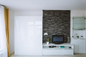 A kitchen or kitchenette at Design apartment, the city centre close to the health spa