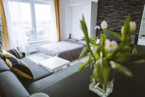 A bed or beds in a room at Design apartment, the city centre close to the health spa