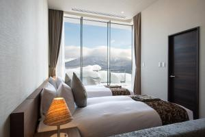 A bed or beds in a room at Ki Niseko