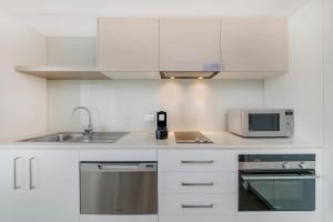 A kitchen or kitchenette at Abode Tuggeranong