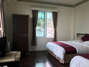 竺園山莊房間的床