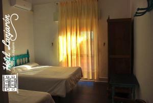 Cama o camas de una habitación en Hotel Lanjaron