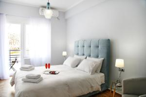 A bed or beds in a room at Hellenic Hospitality House
