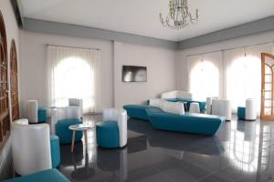 Een zitgedeelte bij eó Suite Hotel Jardin Dorado