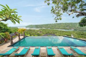 The swimming pool at or near The Acala Shri Sedana
