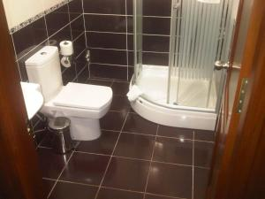 A bathroom at Basileus Hotel