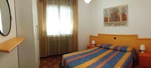 Postel nebo postele na pokoji v ubytování Appartamenti Falco