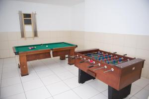 A pool table at Plaza Dutra Hotel