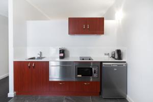 A kitchen or kitchenette at Abode Narrabundah
