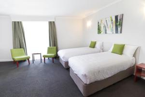 A bed or beds in a room at Abode Narrabundah