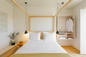 Een bed of bedden in een kamer bij Dona Graca Lisbon Apartments