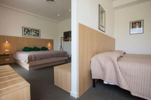 Letto o letti in una camera di Hotel La Tavernetta