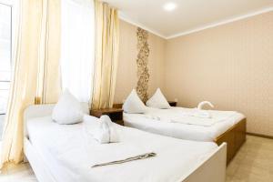 Кровать или кровати в номере Гостевой дом Ласковое море