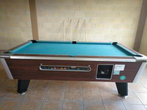 A pool table at Albergue Santiago Apostol