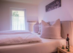 Ein Bett oder Betten in einem Zimmer der Unterkunft FeWo Goebel Beethovenstraße