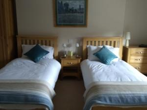 A bed or beds in a room at The Old Rectory Bed and Breakfast