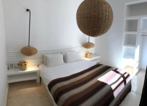 A bed or beds in a room at Villa DAR KAHINA