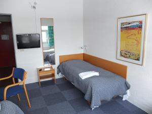 En eller flere senge i et værelse på Motel Spar 10