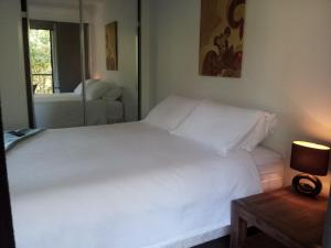 A bed or beds in a room at Our Byron House