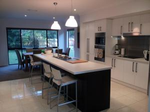 A kitchen or kitchenette at Our Byron House