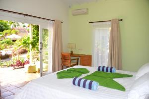 A bed or beds in a room at Gili Meno Eden