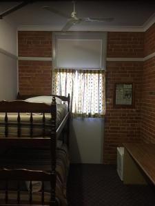 A bunk bed or bunk beds in a room at Heritage Hotel Rockhampton