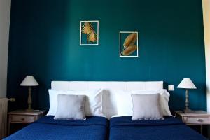 Un ou plusieurs lits dans un hébergement de l'établissement Hotel Les Oliviers