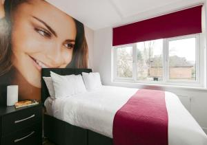 A bed or beds in a room at Wembley Park Hotel