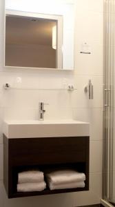 Een badkamer bij Fletcher Hotel-Restaurant Het Witte Huis