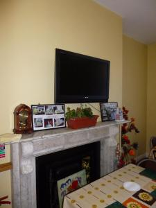 A television and/or entertainment center at Durban Residence