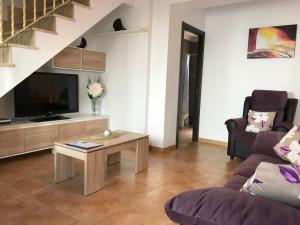A television and/or entertainment center at Leyre`s House