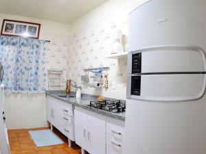 A kitchen or kitchenette at Apartamento da Serra