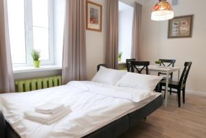 Кровать или кровати в номере Unique Leto Residence